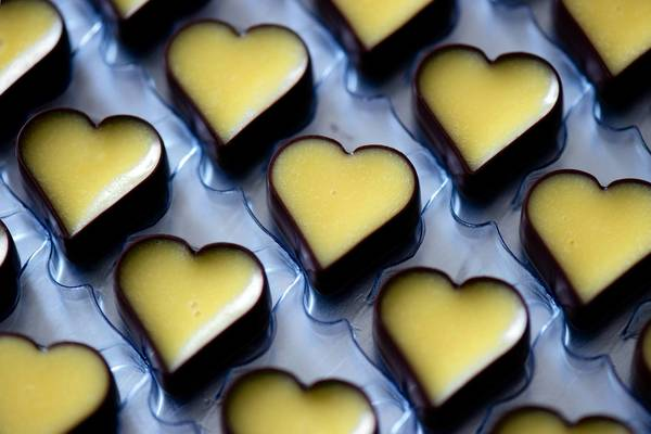 Heart-shaped candies made from advocaat sit in their mold at the chocolate factory in Heidenau, Germany.