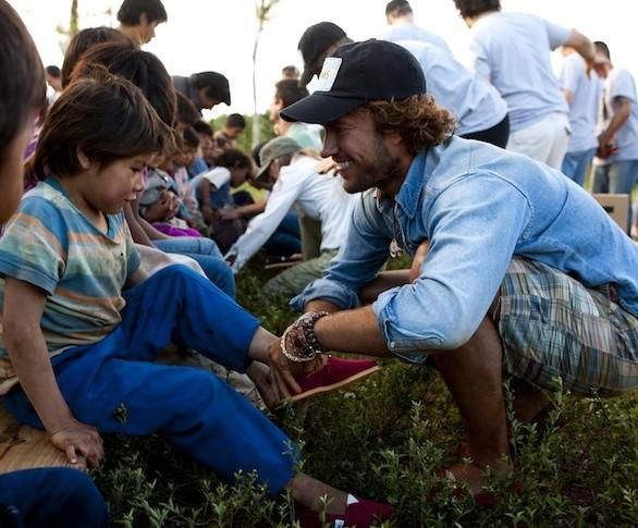 Toms shoes founder Blake Mycoskie delivers new shoes to children in Argentina.