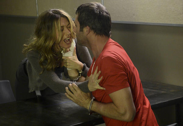 "Joe Carroll (James Purefoy) gets too close to his ex-wife, Claire Matthews (Natalie Zea), in ""The Following."""