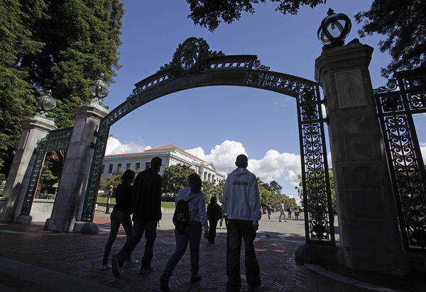 A group of students walk through Sather Gate on the UC Berkeley campus.