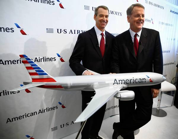 American Airlines CEO Tom Horton, left, and US Airways CEO Doug Parker appear with an airplane model bearing the new American Airlines logo after announcing the two airlines' merger at Dallas-Fort Worth International Airport