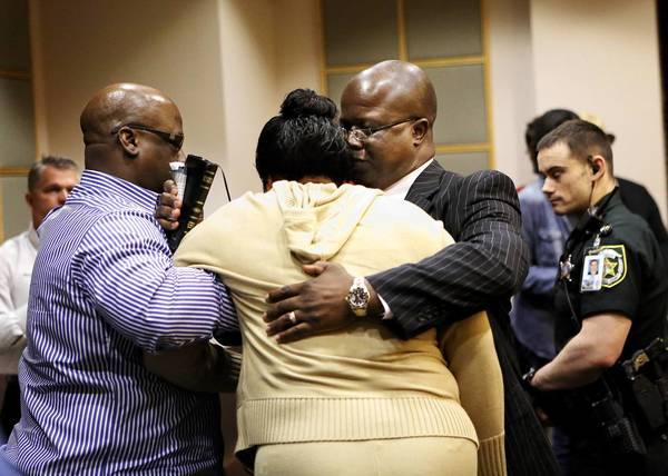 Former Orlando police Officer Timothy Davis Sr. hugs his wife Tarsha at the Orange County Courthouse on Thursday, February 14, 2013 after being found not guilty of murdering his son. (Jacob Langston/Orlando Sentinel)