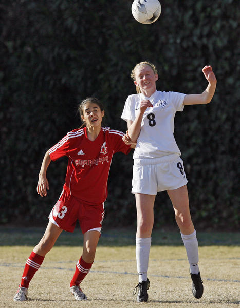 Burroughs' Daisy Castaneda, left, and Flintridge Prep's Cassie Redding fight for the ball during the CIF Southern Section Division III first-round playoffs, which took place at Flintridge Prep in La Canada on Thursday, February 14, 2013.