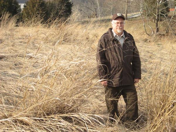 Phil Pannill, land manager at National Conservation Training Center in Shepherdstown, W.Va., stands among the prairie grasses that will be part of a controlled burn this spring.