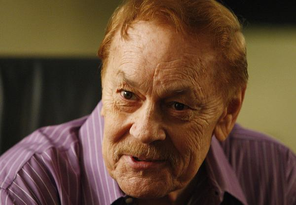 Lakers owner Jerry Buss speaks to reporters before a game against the Houston Rockets.