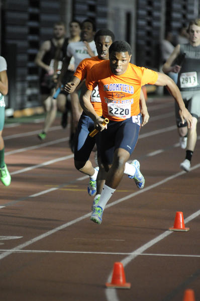 Bloomfield's Andrell Pinnock, 15, takes the baton during the 4x200 meter relay at the Class S boys and girls indoor track championships held in New Haven Thursday.