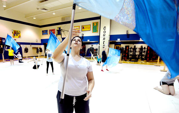 McKenna Alexandra, a member of the Greencastle-Antrim High School indoor guard, works on her routine during practice Thursday night in Greencastle, Pa. The high school will host its 25th annual indoor guard competition on Saturday.