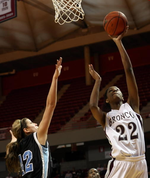 Montini's Malayna Johnson make the lay up against Hillcrest's Yolanda De La Torre during the class 3A girls championship at Redbird Arena in Normal on Friday March 5, 2011.