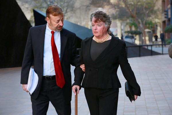 Maureen O'Connor walks to court with her attorney, Eugene Iredale. If O'Connor violates no further laws and makes restitution, the charge of making illegal financial transactions may be dismissed.