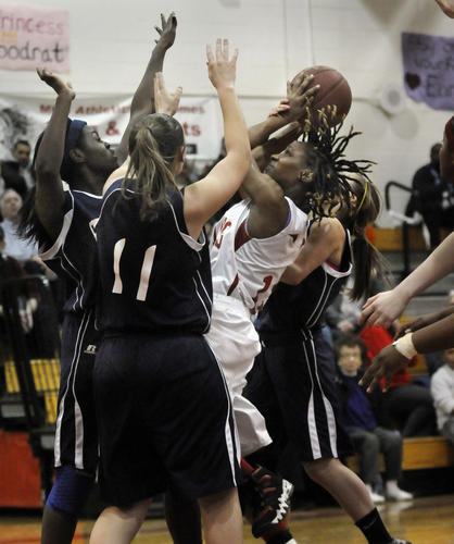 Trecine Breedlove of Manchester gets triple teamed by East Catholic during the first half as she tries to shoot. Manchester hosted East Catholic Thursday night. Manchester won, 51-44.