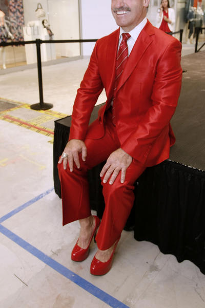 "Former L.A. Kings player Daryl Evans poses wearing his 6-inch red heels before the ""Go Red For Women Heels For Hearts"" event at the Glendale Galleria in Glendale on Thursday, February 14, 2013.  Dozens of people participated in the walk around inside the mall. The event was held to raise awareness of heart disease at this 3rd annual event."