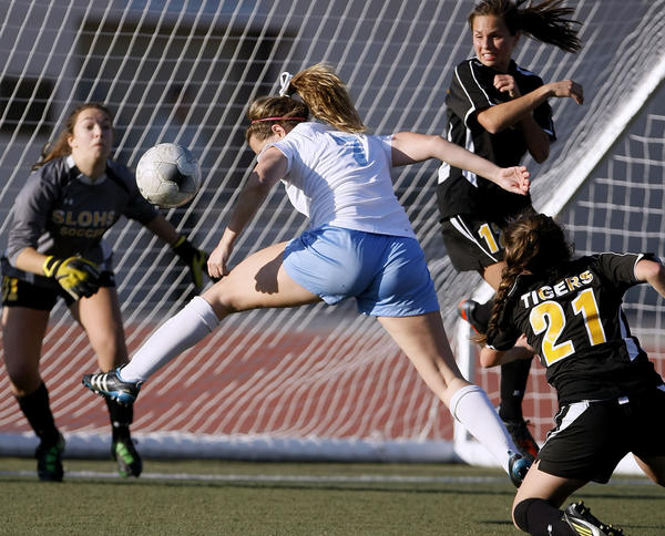 Crescenta Valley High's #7 Whitley Boller just misses a header in front of the goal during CIF SS Div. III first round girls' soccer playoff vs. San Luis Obispo High School at Crescenta Valley High School in La Crescenta on Thursday, February 14, 2013. CV won 1-0.