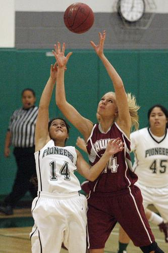 Providence's Estelle Glorioso, left, and Calvary Chapel's Anika Bousema fight for a loose ball during the CIF Southern Section Division V-AA first-round playoffs, which took place at Providence High School in Burbank on Thursday, February 14, 2013.