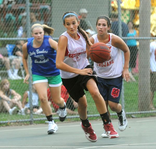 Parkland's Hannah Gombos (13) center, steals the ball away from Palmerton in the second round game during the Stellar girls basketball tournament held at Cedar Beach Park in Allentown July 07, 2011.