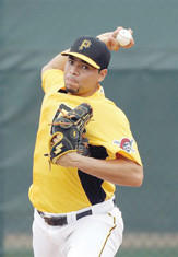 Pittsburgh Pirates pitcher Jeanmar Gomez throws during a baseball spring training workout Wednesday in Bradenton, Fla.