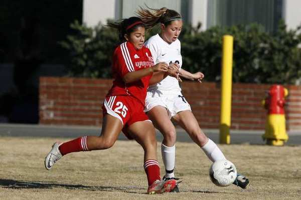 Flintridge Prep senior forward Kaelin King, right, scored the Rebels' second goal in the 38th minute.