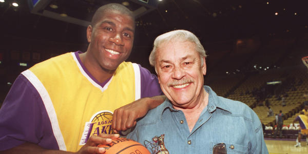 Magic Johnson poses with Jerry Buss before a Lakers game.