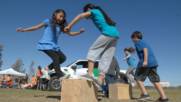 Fourth-graders perform exercises on jump boxes during a Nutrition Olympics activity at Ben Hulse Elementary School in Imperial on Thursday.