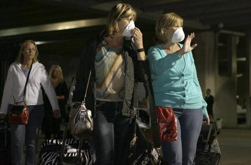 "Passengers leave the Carnival Triumph cruise ship after reaching the port of Mobile, Alabama, February 14, 2013. The crippled cruise ship that lost power for more than four days in the Gulf of Mexico was pulled into a port in Mobile, Alabama, late on Thursday as passengers cheered the end of a ""hellish"" voyage marked by overflowing toilets and stinking cabins."