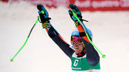 Ted Ligety exults after winning Friday's giant slalom for his third gold at 2013 World Championships. (Samuel Kubani / AFP / Getty Images)