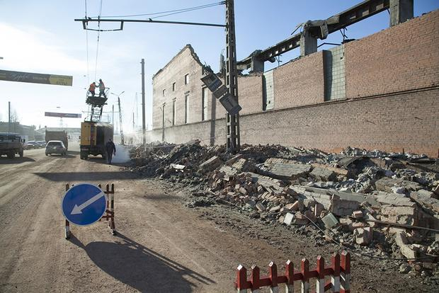 Workers repair a damaged power circuit outside a zinc factory where a roof collapsed after a meteor exploded over the Chelyabinsk region.