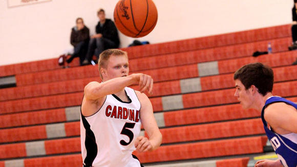 J-L junior Tyler Tarbutton zips off a pass in the Cardinals' overtime victory against Inland Lakes Wednesday.