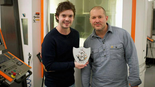 """Blue Peter's' Barney Harwood, left, presents Jonny Ive with his badge."