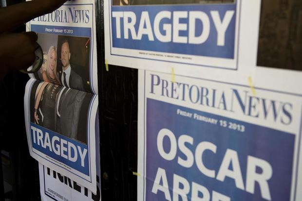 South African newspapers blare the incredible news of the arrest of Oscar Pretorius on a charge of murder.