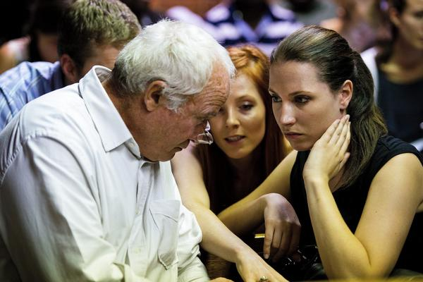 """Henke Pistorius, father of Oscar Pistorius, sits in court with Oscar's sister, Aimee. In a statement, Pistorius' family denied that the athlete had murdered his girlfriend, saying: """"The alleged murder is disputed in the strongest possible terms."""""""