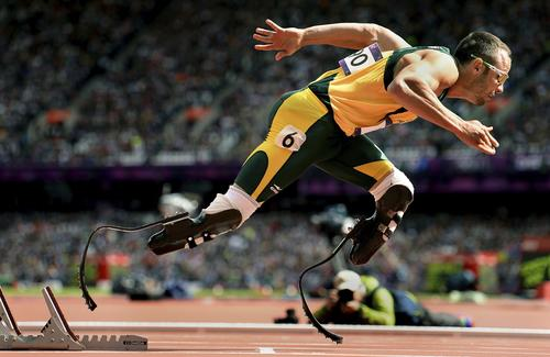 South Africa's Oscar Pistorius leaves the starting blocks in a first-round heat of the men's 400 meters at the 2012 London Olympics.