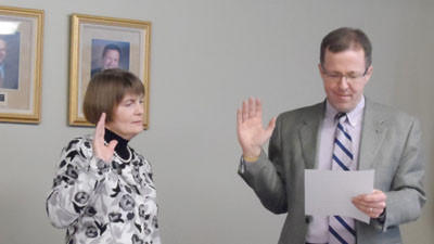 Petoskey school board appointee Kathy Reed takes the oath of office administered by superintendent John Scholten. Reed was appointed in a special meeting on Thursday, Feb. 14 to fill the vacancy left when Jack Waldvogel resigned for health reasons.