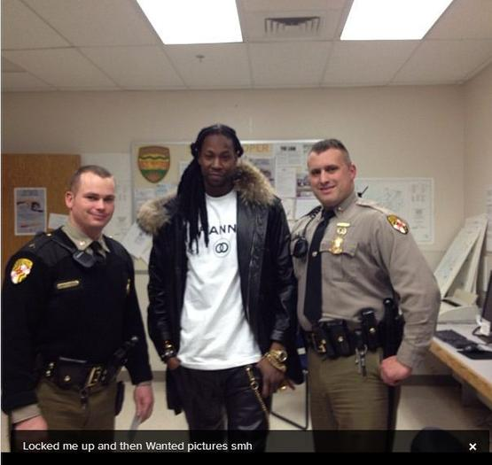 Police are reviewing the circumstances around this photo of rapper 2 Chainz posing with state troopers who he said arrested him