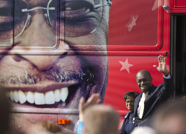 Former Republican presidential candidate Herman Cain, stepping from his campaign bus in December 2011, has signed with Fox News as a political contributor.