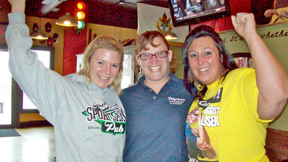 "Jamie  Newhouse, Colleen Hickey and Allison Barb (l-r) are pumped up for the  ""Biggest Loser  Challenge"" at the Alpine Tavern and Eatery¿s Sport Haus Pub."