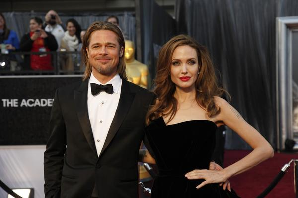 "Brad Pitt and Angelina Jolie are toasting to their new wine, possibly with the new rose itself.  The engaged power couple is releasing a vintage pink rose from their 1,000-acre French estate on March 15 in the United States. It will be the first offering from their vineyard, which they acquired in 2008.  The name of the wine? Miraval, the same name as their Chateau Miraval in Correns, France. The vineyard's predecessor had been called Pink Floyd -- the band recorded its album ""The Wall"" in studios on the estate grounds.  ""We are intimately involved and quite enthused over the wine project with our friends the Perrin family,"" Pitt told Bloomberg through his rep.  <br><br> <strong>Full story:</strong> <a href=""http://www.latimes.com/entertainment/gossip/la-et-mg-brad-pitt-angelina-jolie-wine-miraval-0130214,0,6620949.story"">Brad Pitt, Angelina Jolie launching Miraval wine</a>"