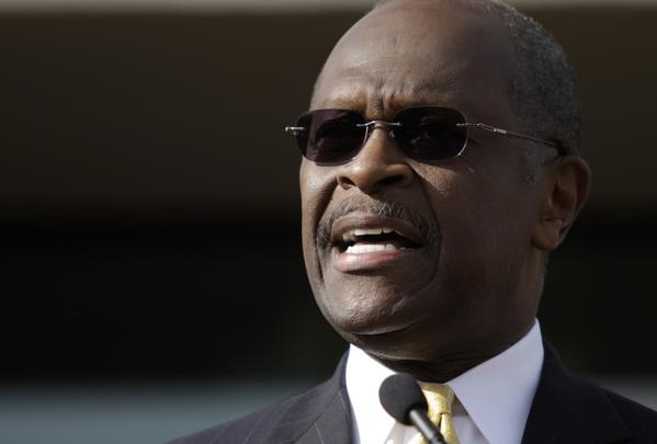 "Image of Herman Cain as he announced he was ""suspending"" his campaign for president in wake of allegations of extramarital affairs."