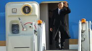 Obama lands at O'Hare