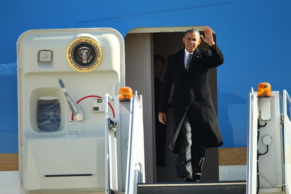 President Barack Obama lands at O'Hare International Airport to attend Hyde Park Academy in Chicago, Illinois, to discuss proposals unveiled in the speech that focus on strengthening the economy for the middle class and those striving to get there.
