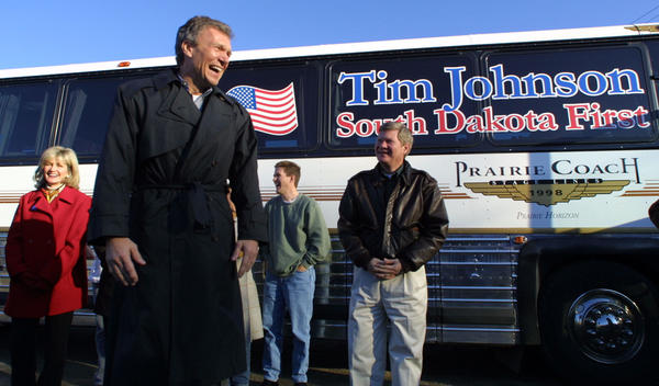 U.S. Senator and Senate Majority Leader Tom Daschle, second from the left, laughs after joking that the campaign stop by he and U.S. Senator Tim Johnson, right, was free and required no ticket to get in Saturday Nov. 2, 2002 in Aberdeen, S.D. Daschles remarks were in reference to the people who had tickets but were unable to get in to President George W. Bush's visit to Aberdeen last week. Johnson and Daschle made a campaign stop in Aberdeen, Daschle's hometown, as part of a state-wide bus tour for Johnson who is in a close senate race with U.S. Rep. John Thune. (AP Photo) (Aberdeen American News, John Davis)