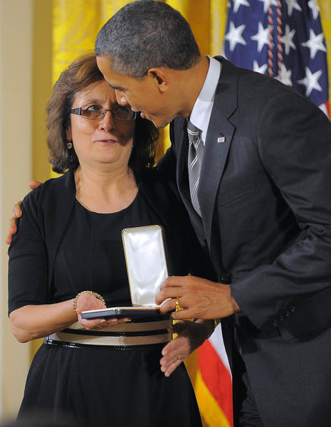 Maria Gomez receives her medal from President Barack Obama during the Presidential Citizens Medal ceremony at the White House.