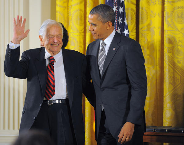 Terry Brazelton, M.D. waves while he stands with President Barack Obama during the Presidential Citizens Medal ceremony at the White House.