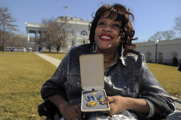 Marylander Janice Y. Jackson holds her Presidential Citizens Medal following the ceremony at the White House.