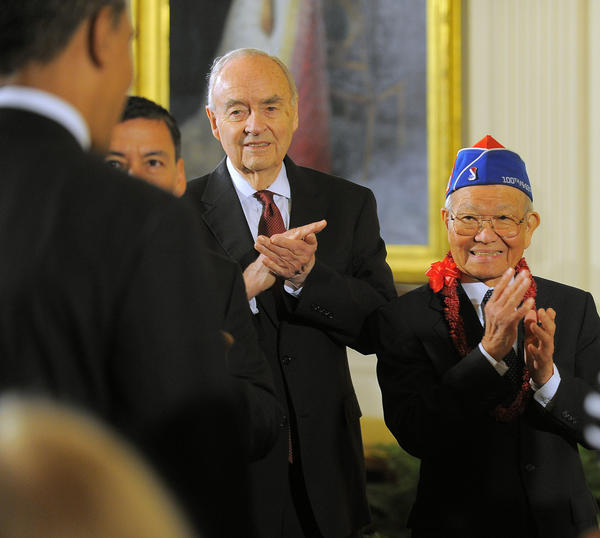Harris Wofford (left) and Marylander Terry Shima (right), Executive Director of the Japanese American Veterans Association, applaud as President Barack Obama enters to host the Presidential Citizens Medal ceremony at the White House.