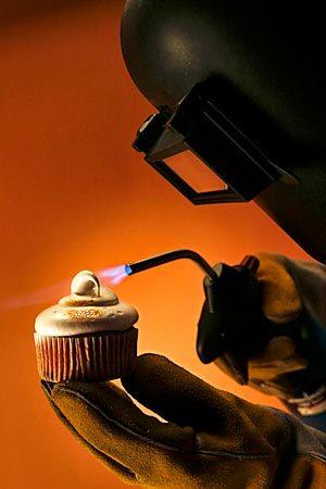 Food cover shot for a story about using a blowtorch in the kitchen. We were looking for a somewhat humorous approach to the shot, taking the theatrics of kitchen pyrotechnics one step further by adding a welder's mask and gloves to an otherwise simple shot of bruleeing a s'mores cupcake. Click here for the story.