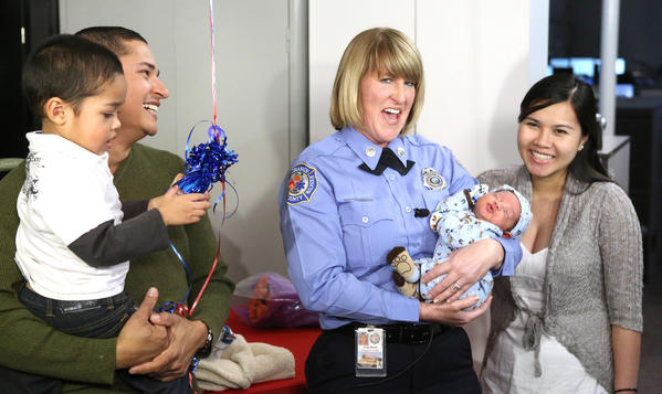 Scenes from the press conference with Orange County Fire Rescue dispatcher Jody Thacker meeting baby Alex for the first time, Friday, February 15, 2013, after talking dad-to-be Marco Lozada through the birthing process over the phone. Looking on is Alex' mom Nancy Lozada and Alex' brother Evan, 3.