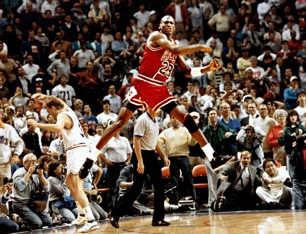 "May 7, 1989: Three seconds separated the Bulls from advancing to the second round of the playoffs for the first time since the 1980-81 season, and Jordan wanted ""The Shot."" He shook free of harassing Cavaliers defender Larry Nance to take the inbound pass from Brad Sellers. Jordan dribbled left twice to the foul line then launched a hanging, reload jumper over Craig Ehlo that rattled in at the buzzer, giving the Bulls a 101-100 victory and a 3-2 first-round-series win. Jordan, who scored 44, catapulted into the air and pumped his fist four times after the game-winner. One can almost hear Jim Durham and Johnny ""Red"" Kerr screaming ""Bulls win!"""