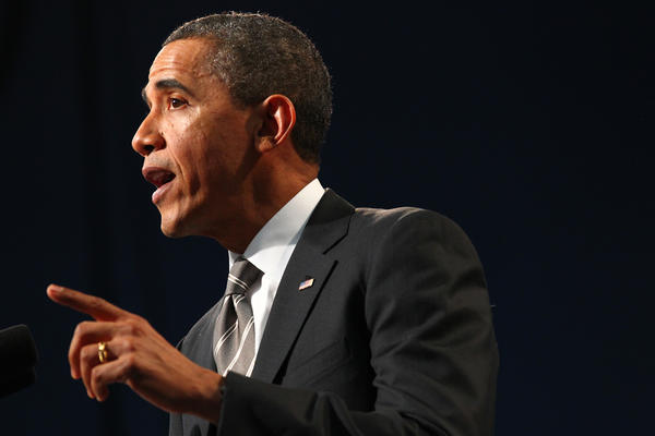 President Barack Obama addresses gun violence and the economy during a speech at Hyde Park Academy in Chicago.