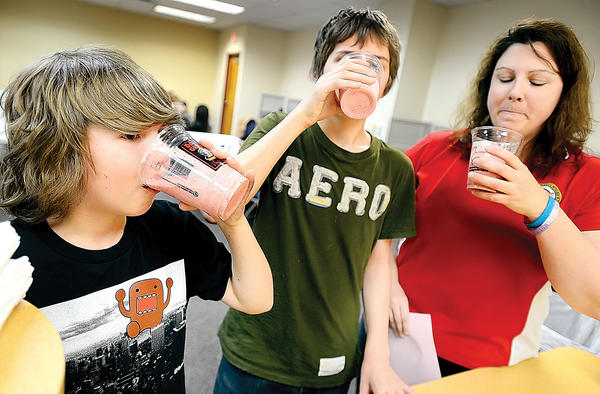 Tasting banana-strawberry yogurt smoothies in the BodyWorks class are, from left, brothers Josh Blankenship and Zack Blankenship, and their mother, Jennifer Tilley, of Bolivar W.Va.