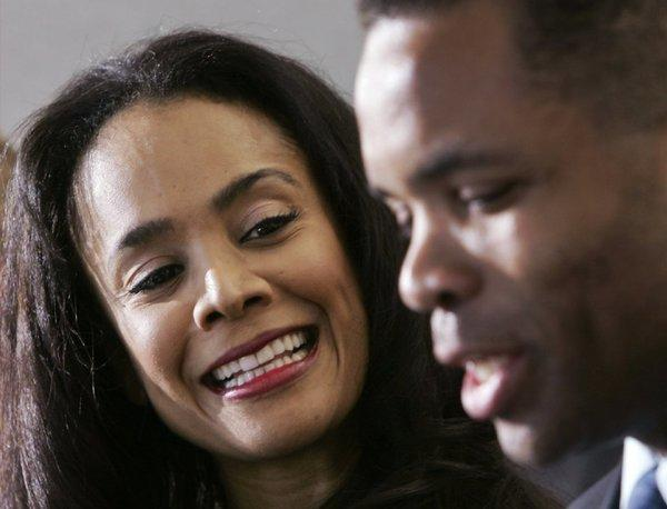 Former U.S. Rep. Jesse Jackson Jr., right, and his wife, Sandi, are shown in a 2006 photo.