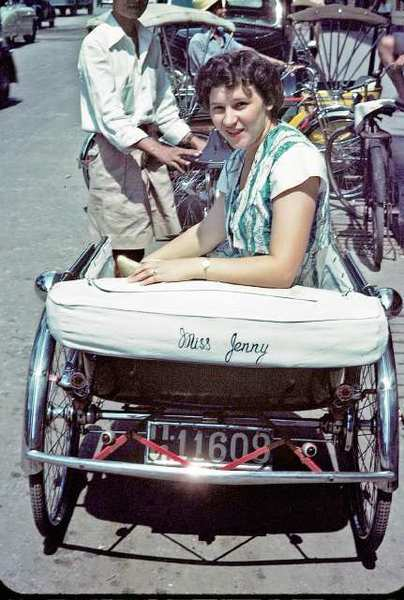 "Jean Armstrong, also known as ""Jungle Jenny,"" takes a ride in her personalized pedicab in Bangkok, Thailand, circa 1950."